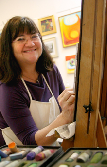 Kathy at her easel in her studio