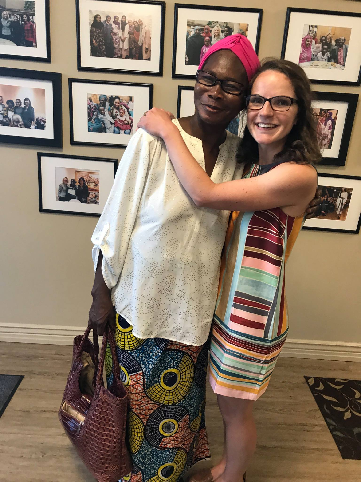 Abby shares a special moment with a friend she's made working here at Women of the World.