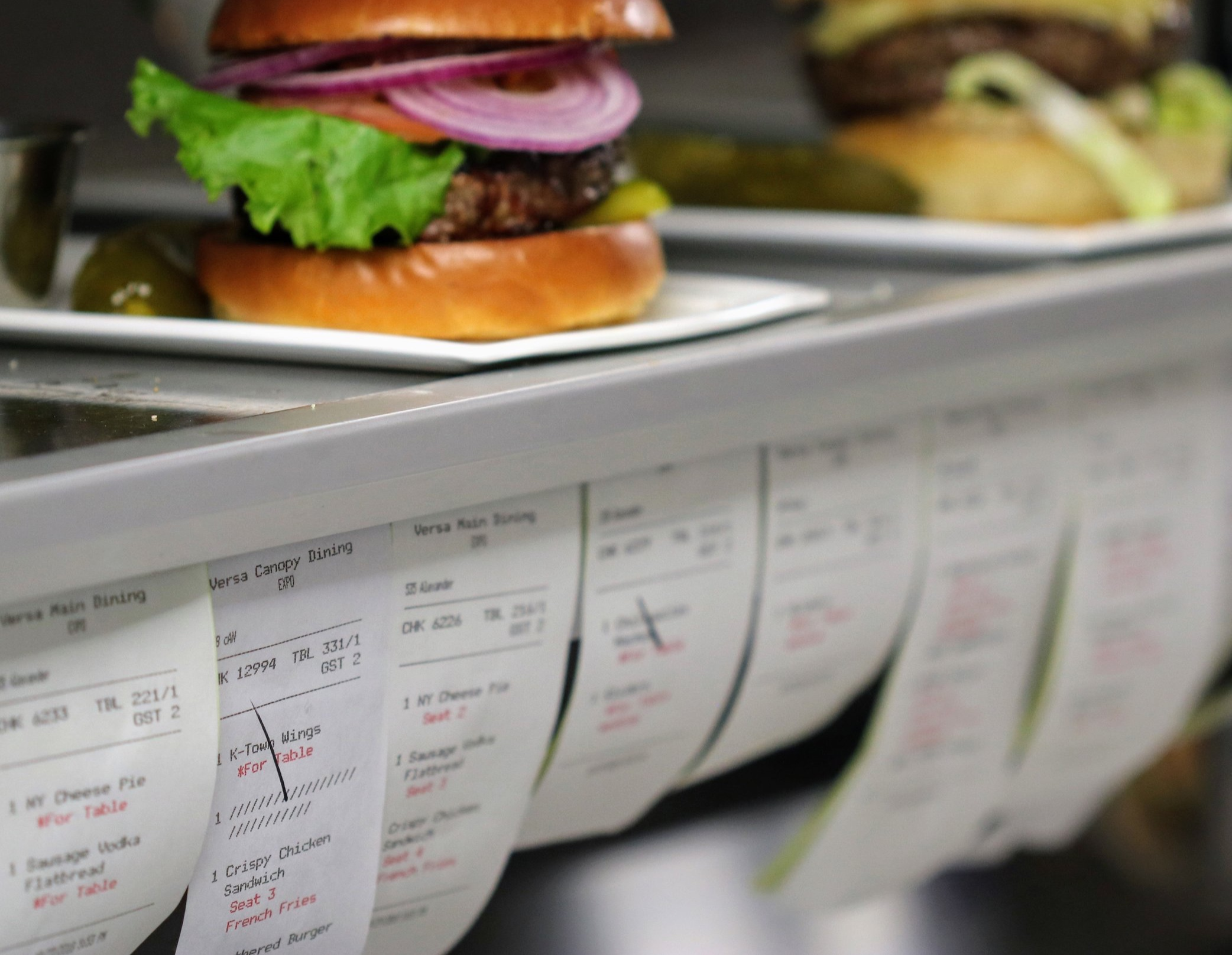 Image of kitchen with burgers on a shelf.