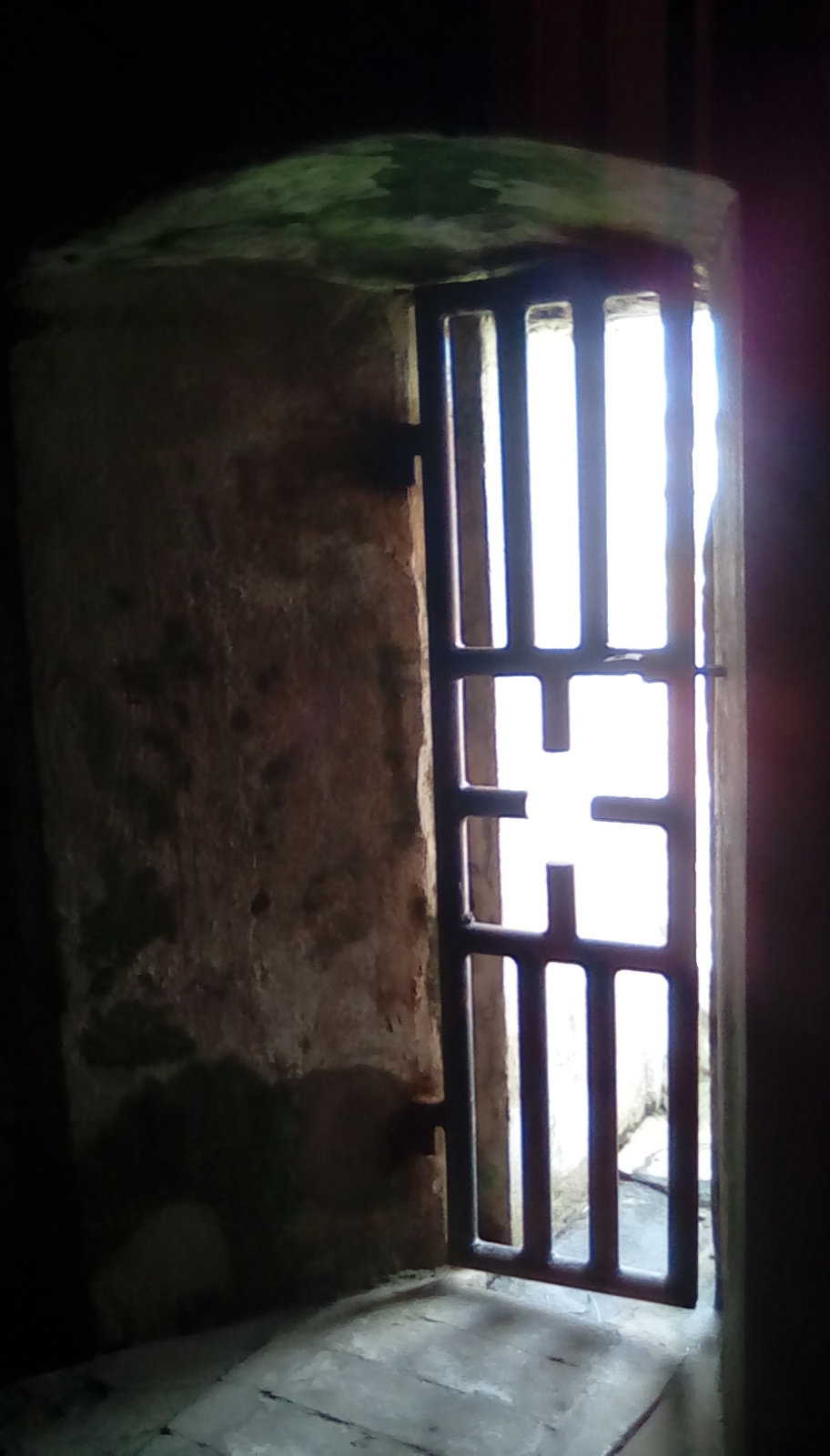 Elmina Slave Castle - cell gate.jpg