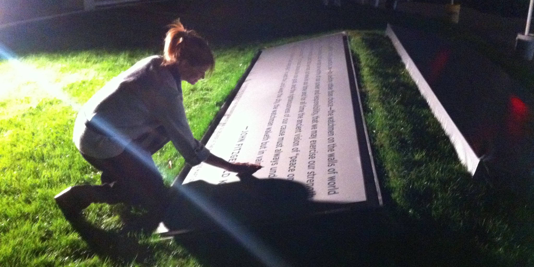 "4am November 18, 2013, Dealey Plaza: Elizabeth reviewing engraving quality for ""JFK's 50th"" commemorative piece, Dallas, Texas."