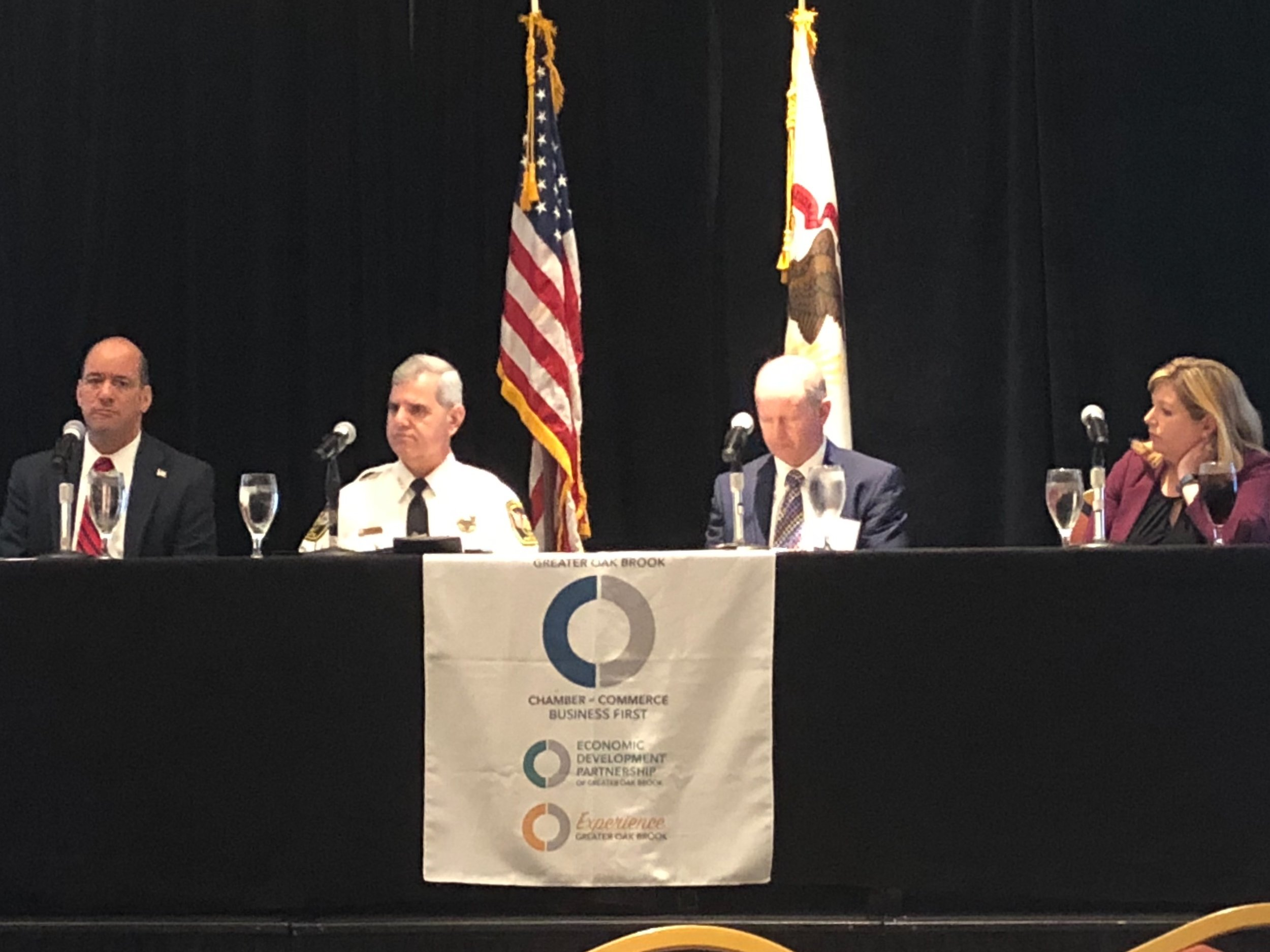 The forum speakers (L-R): DuPage County State's Attorney Bob Berlin, Oak Brook Police Chief James Kruger, Serve and Protect's Joe Crimmins, and Inland Bank's Nora O'Connor.