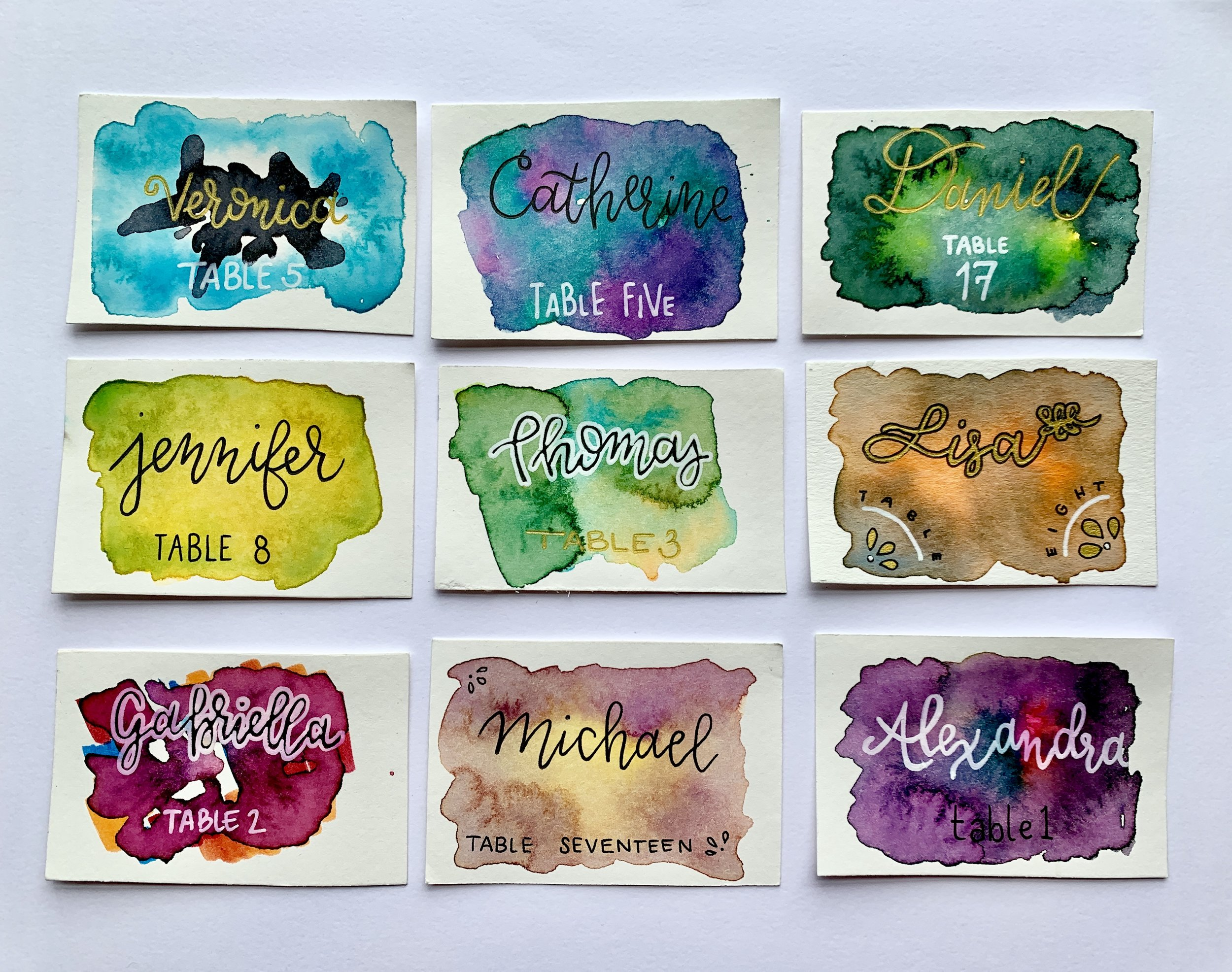 Place cards with watercolor background and gel pen lettering