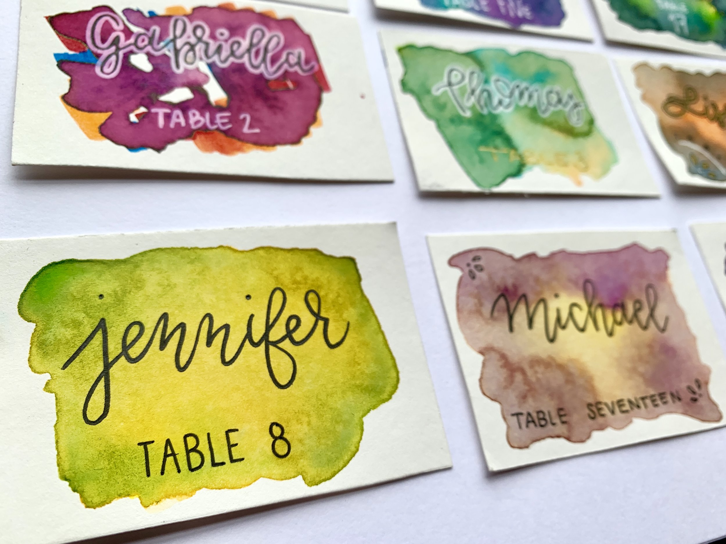 Close-up of watercolor place card
