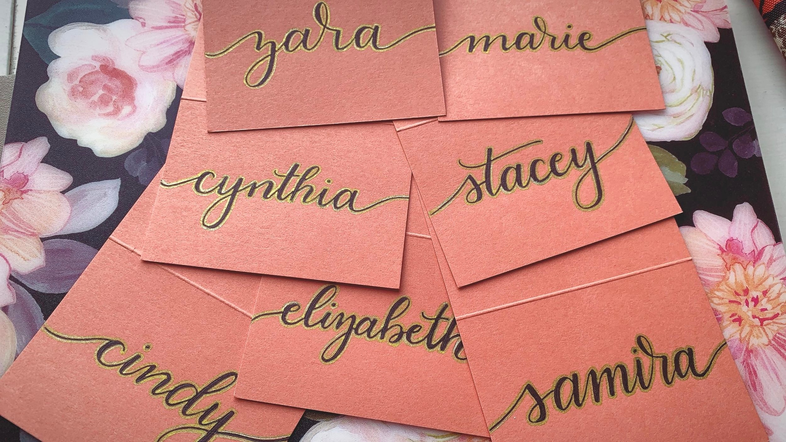 Black and gold gel pen lettering for place cards