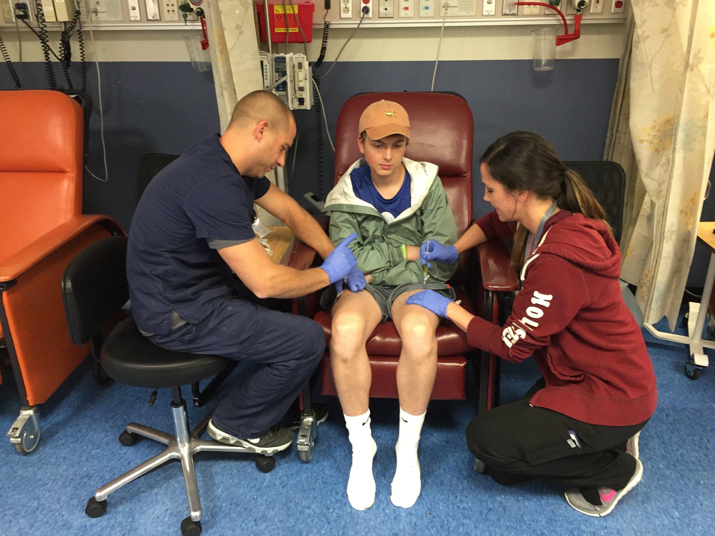 Adam receiving chemo in both legs days before running the St. Jude half marathon.