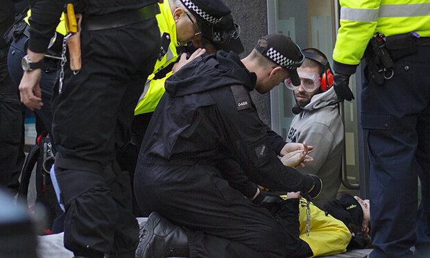 AR members locked themselves to Defra's headquarters on Wednesday. Photograph: Sammi Drew