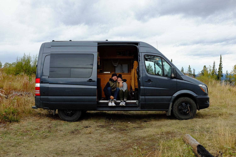 Katie Larsen and her partner in their van.