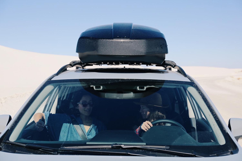 Nic Annette Miller riding shotgun and Sarah Uhl behind the wheel en route to Marfa — photo by Kristen Blanton