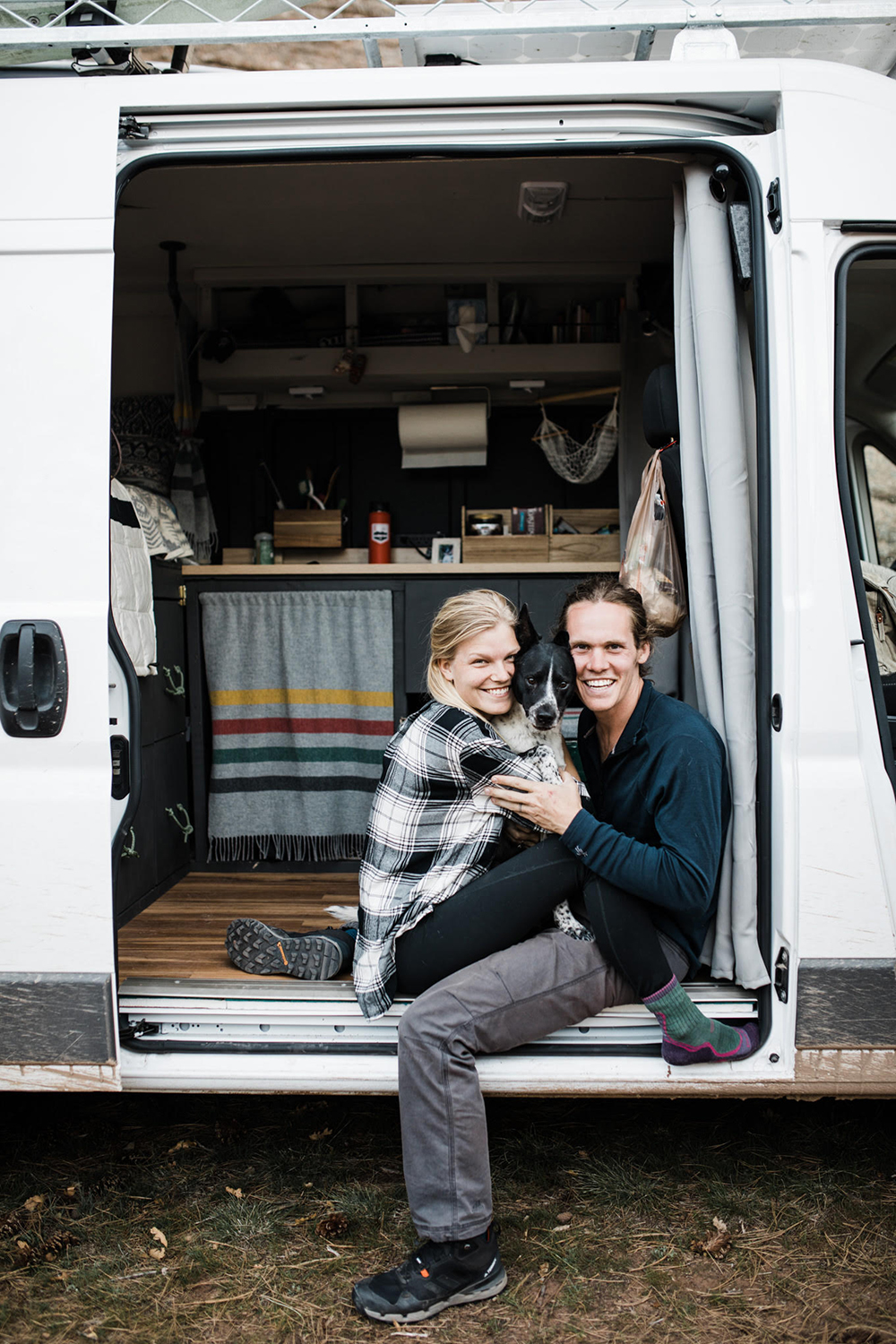 Abbi and Callen in their self-converted camper van