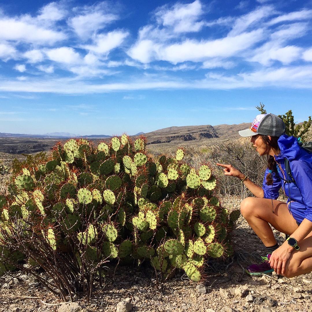 Liz gets close to a cactus