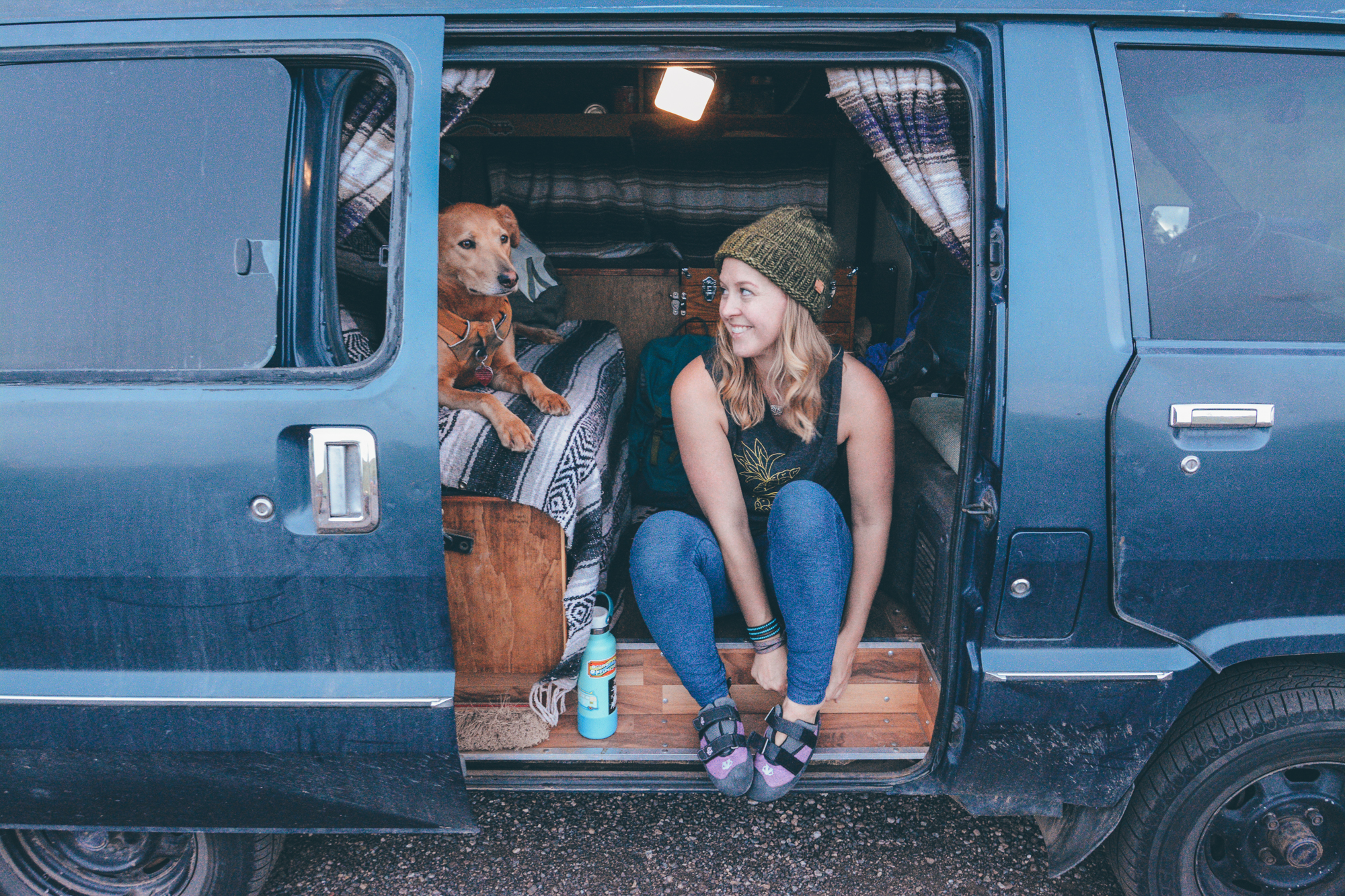 Kathleen Morton in her vintage Toyota camper with her dog, Peaches — photo by Allison Mayor
