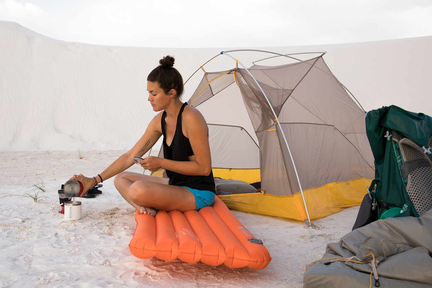 Elizabeth Brentano making coffee at White Sands National Monument