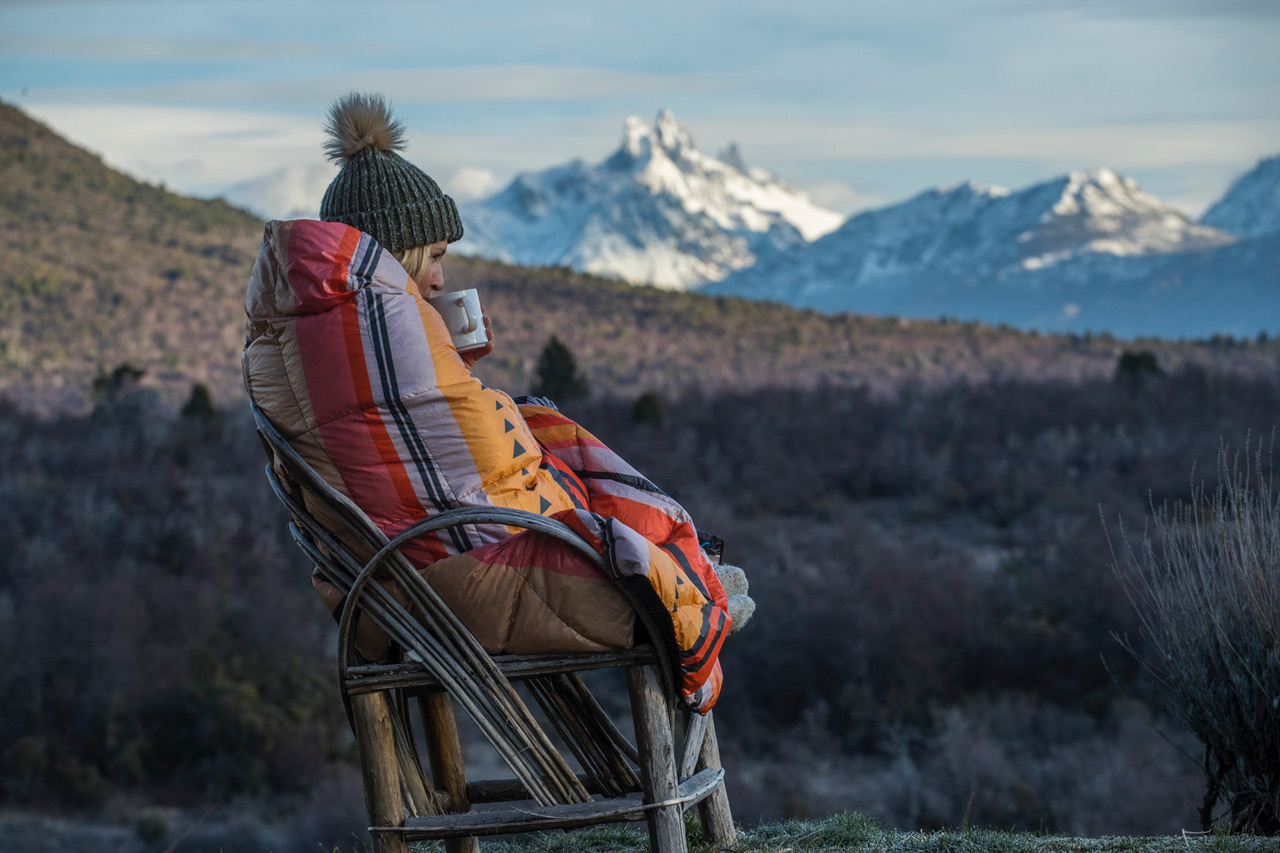 Amie Engerbretson wrapped in a Rumpl blanket in Patagonia