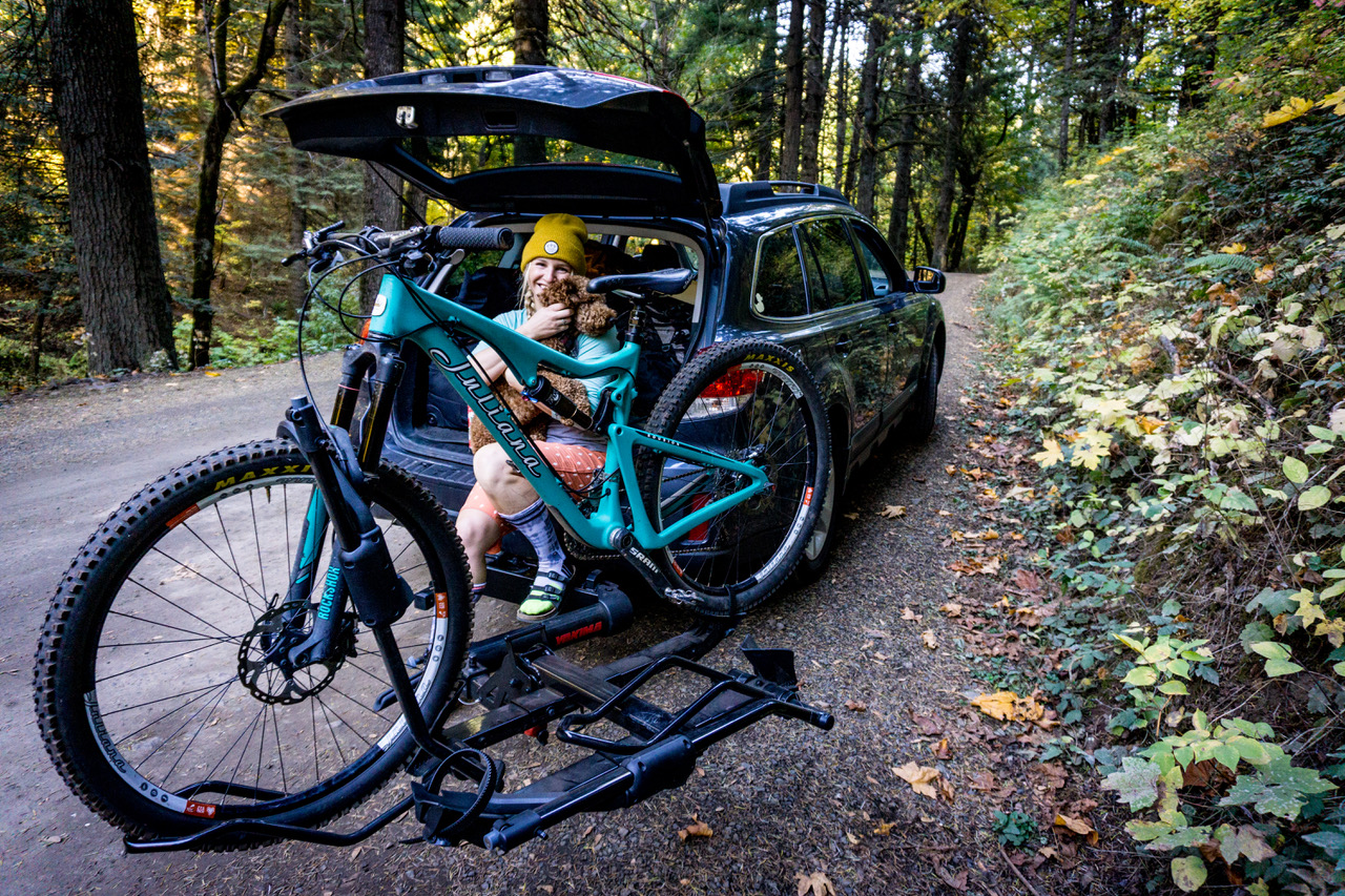 Amie Engerbretson sitting at a trailhead with her Yakima bike rack
