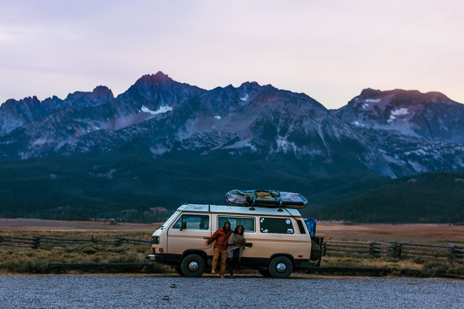 Noami and her husband Dustin in front of their VW Vanagon at blue hour