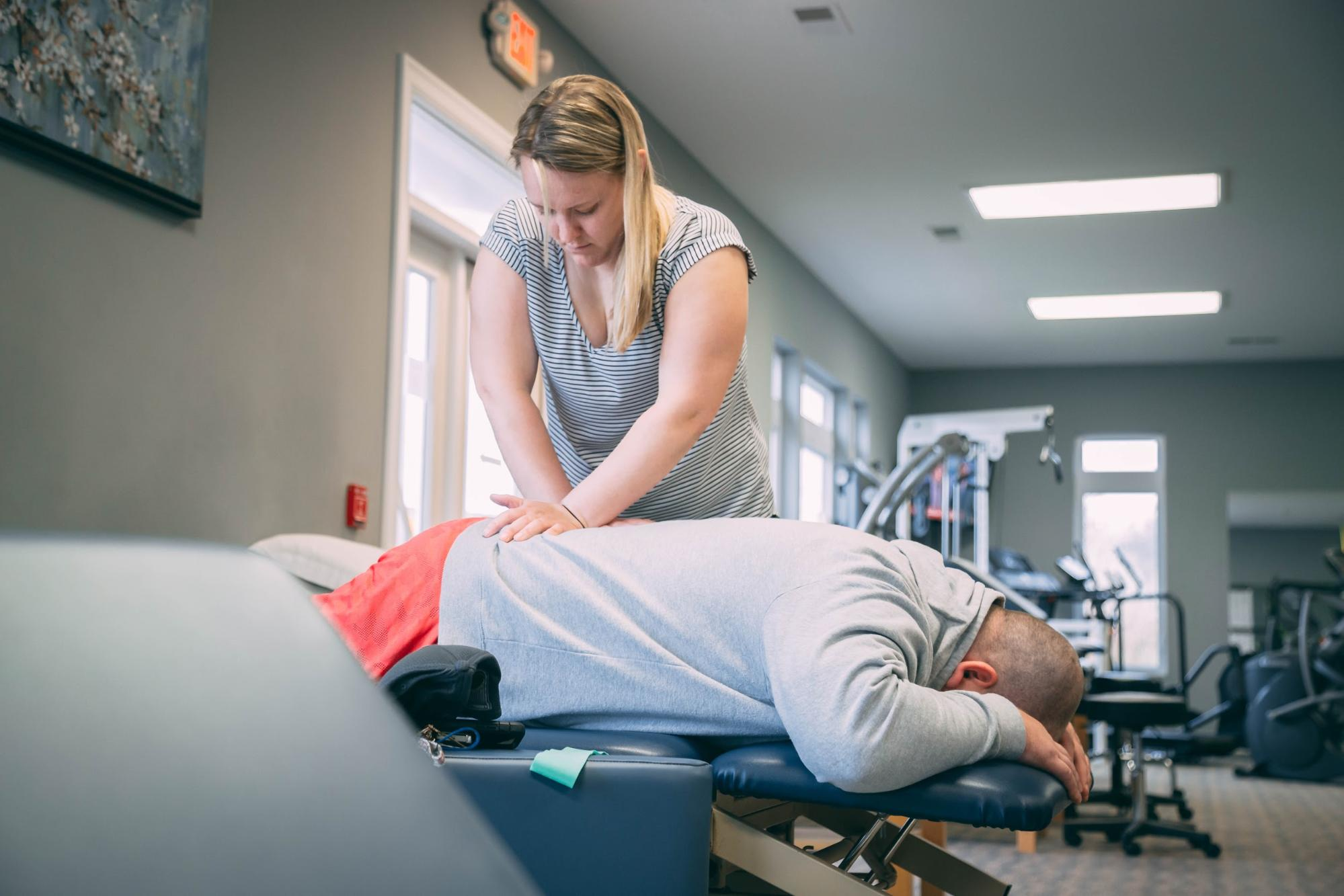 Lattimore Physical Therapist massaging patient's back laying down