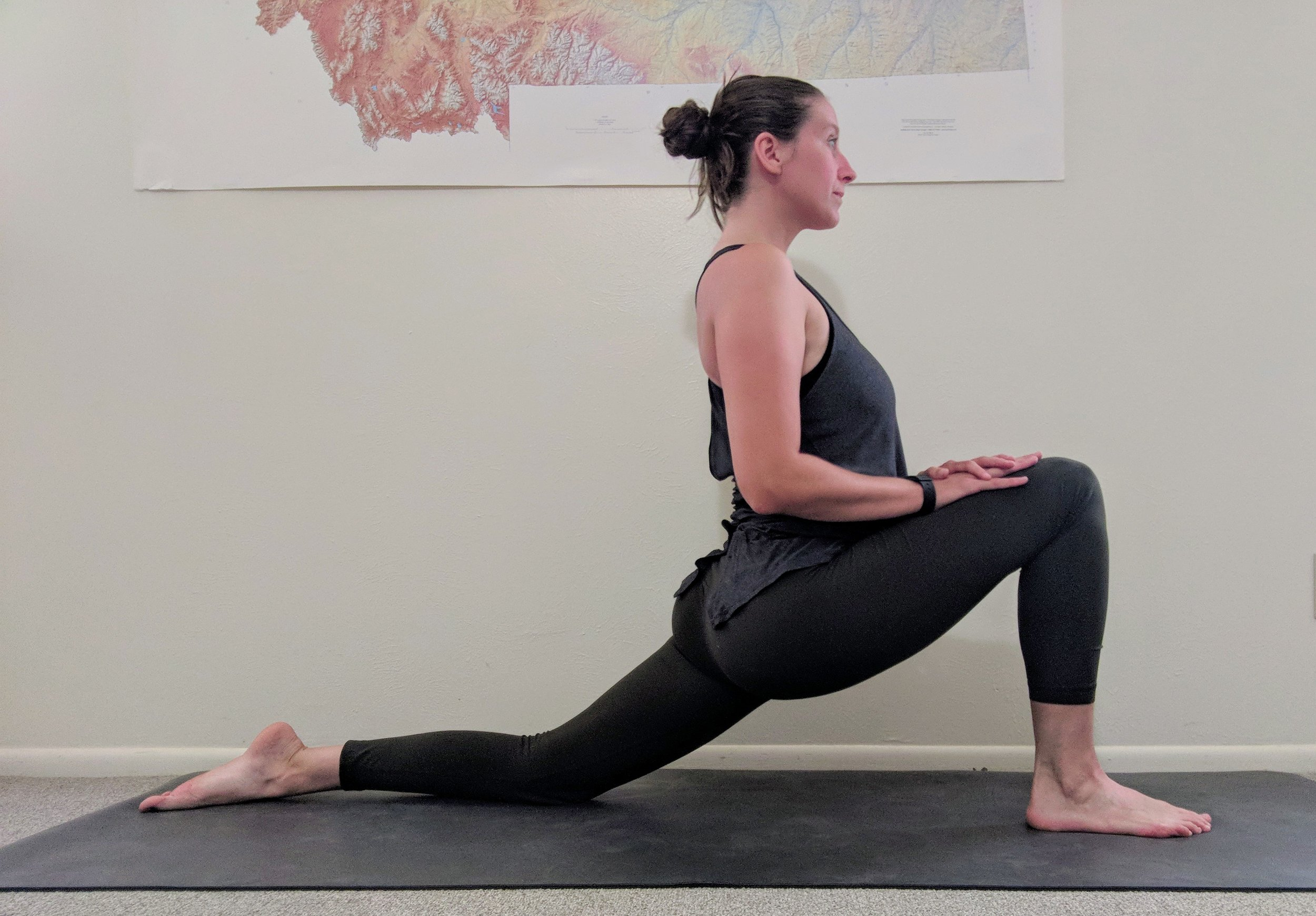 low lunge - From forward fold, plant your hands into the mat and step your right foot long behind you, lower your right knee. Your back toes can be either tucked or untuckedAdjust your left foot so that your knee is stacked above your ankleLengthen your spine and press down into your hipsMODIFICATION: Use two blocks under your palms to lengthen your spine if you can't reach the groundMODIFICATION: If you have knee pain, fold a blanket under your back knee to lessen the impact