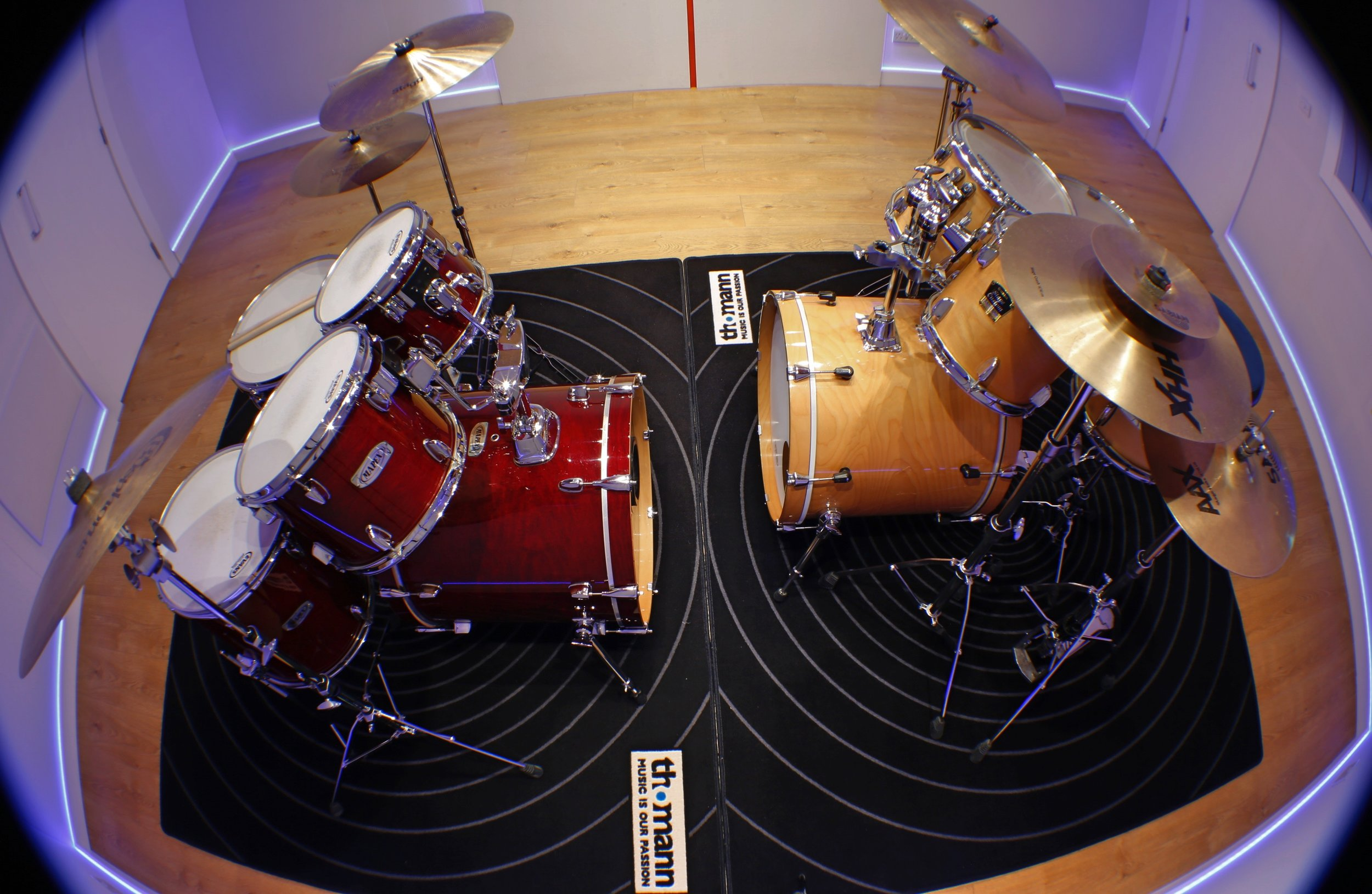 Lesson room where tutor and student play drums together.