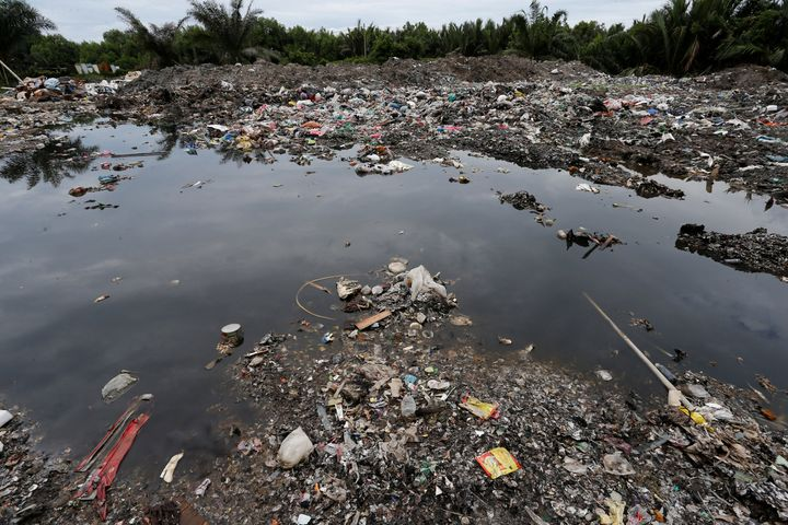 LAI SENG SIN / REUTERS  Plastic waste is seen dumped at a palm oil plantation in Telok Panglima Garang, Malaysia in October.