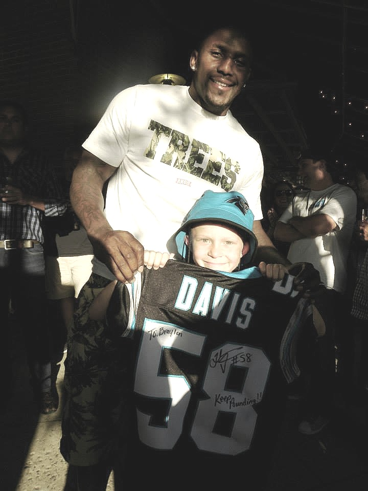 Thomas Davis of the Carolina Panthers stops by the Roaring Riot event to surprise Braylon with a jersey and donation