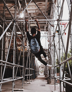 Young man hanging on a scaffolding (small).jpg