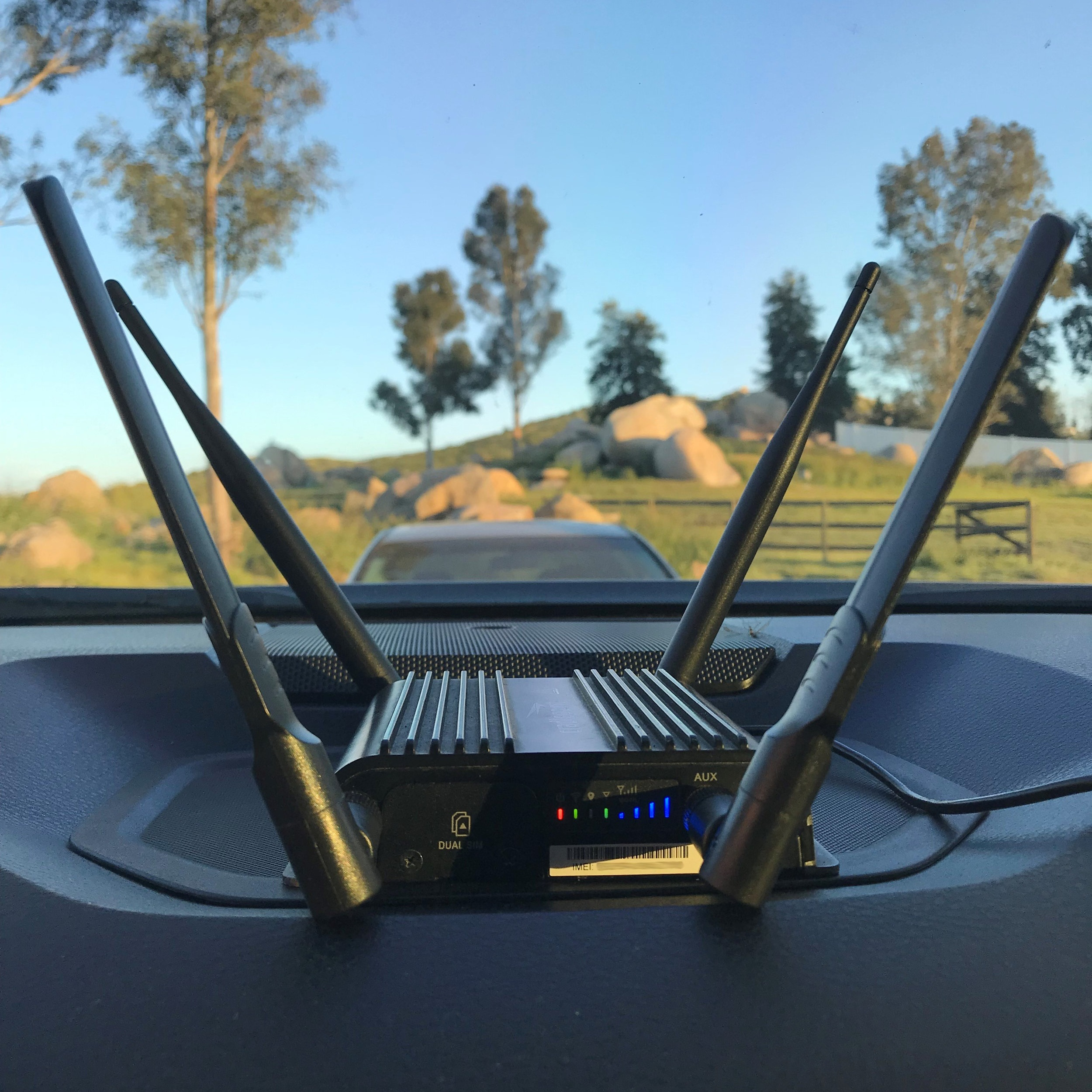 cell modem 900 vehicle setup with stick antennas.jpg