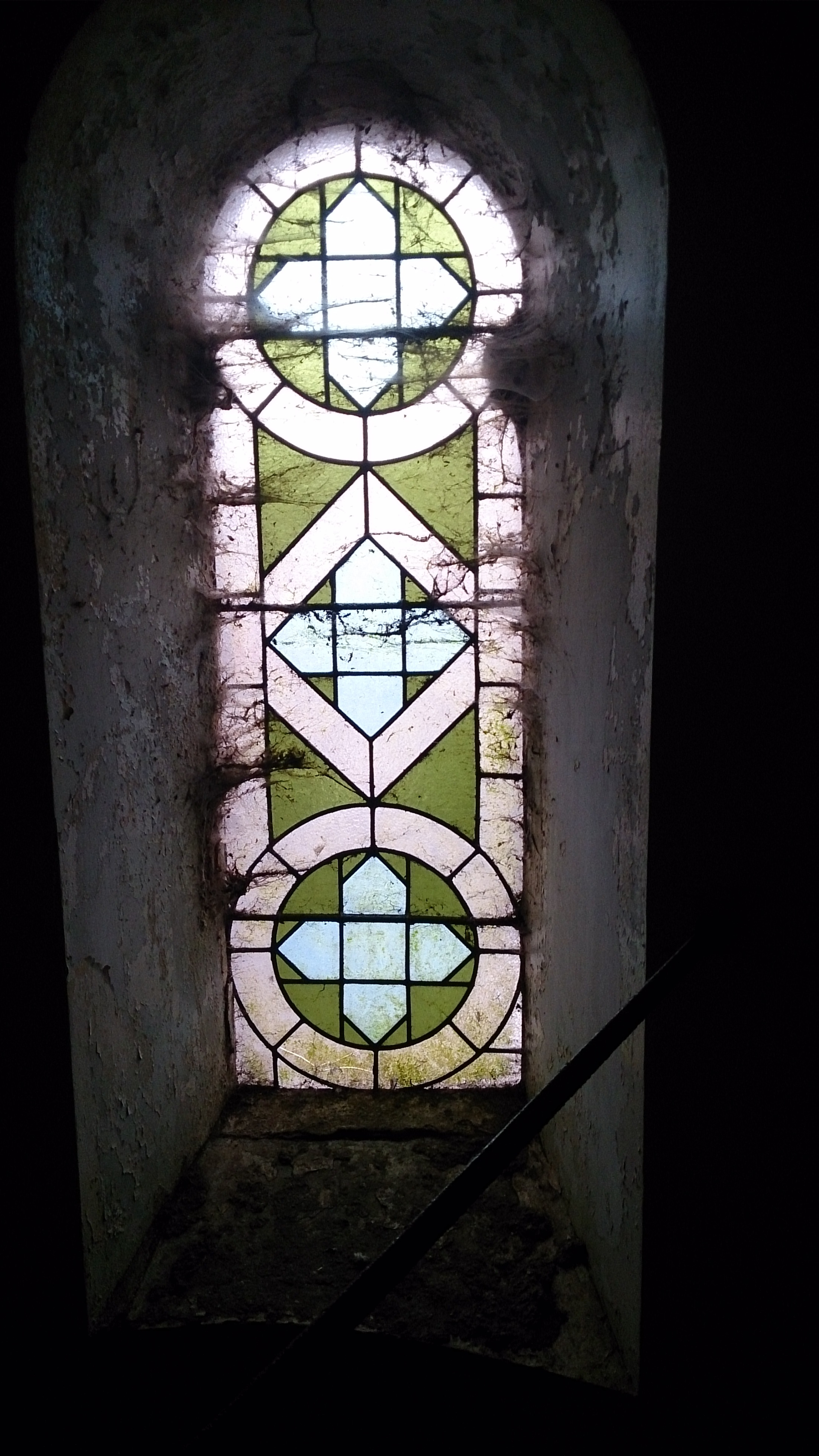 stained glass in gallery.JPG