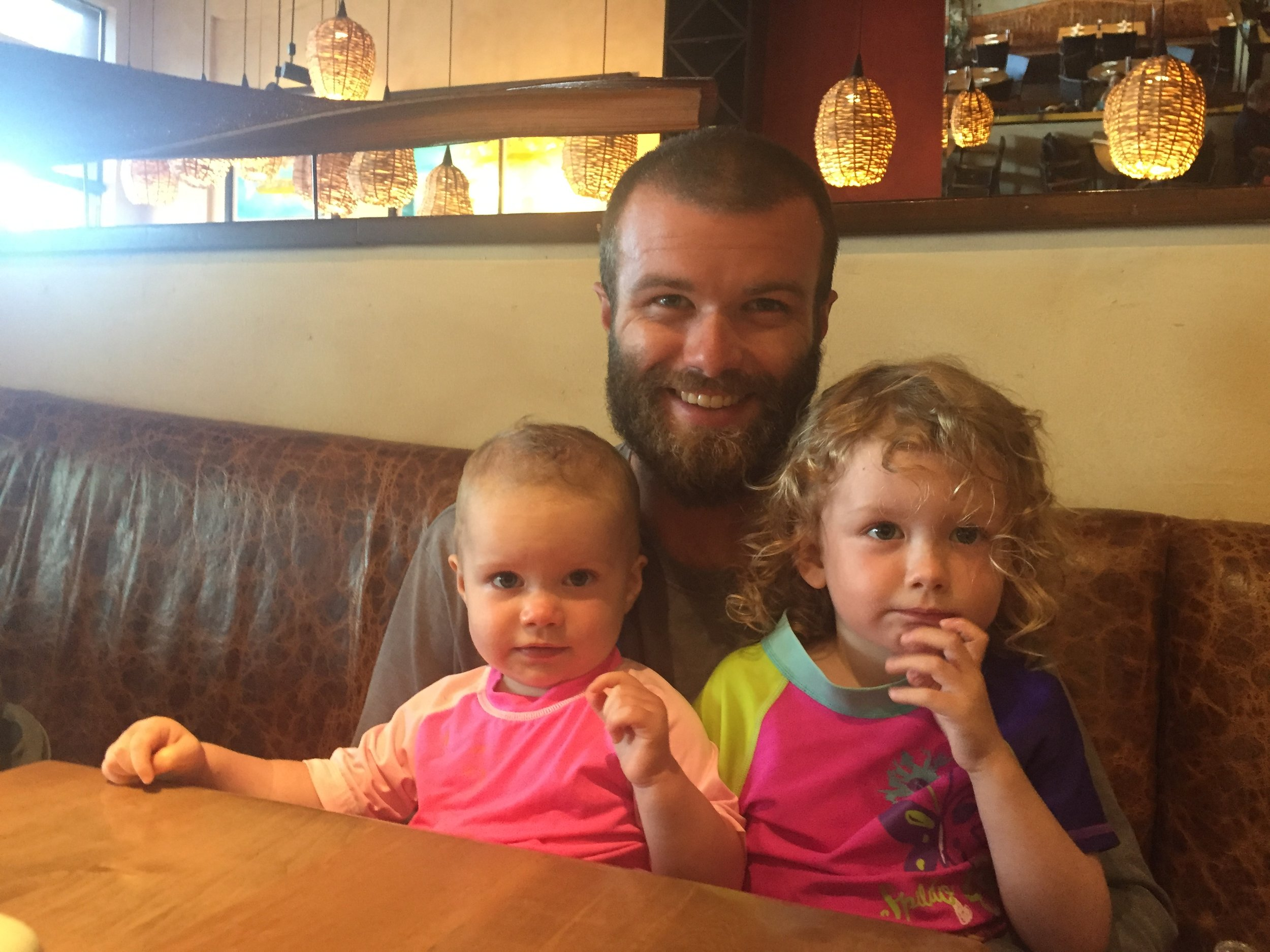 Daddy with his girls, out to eat in Coconut Grove, FL.