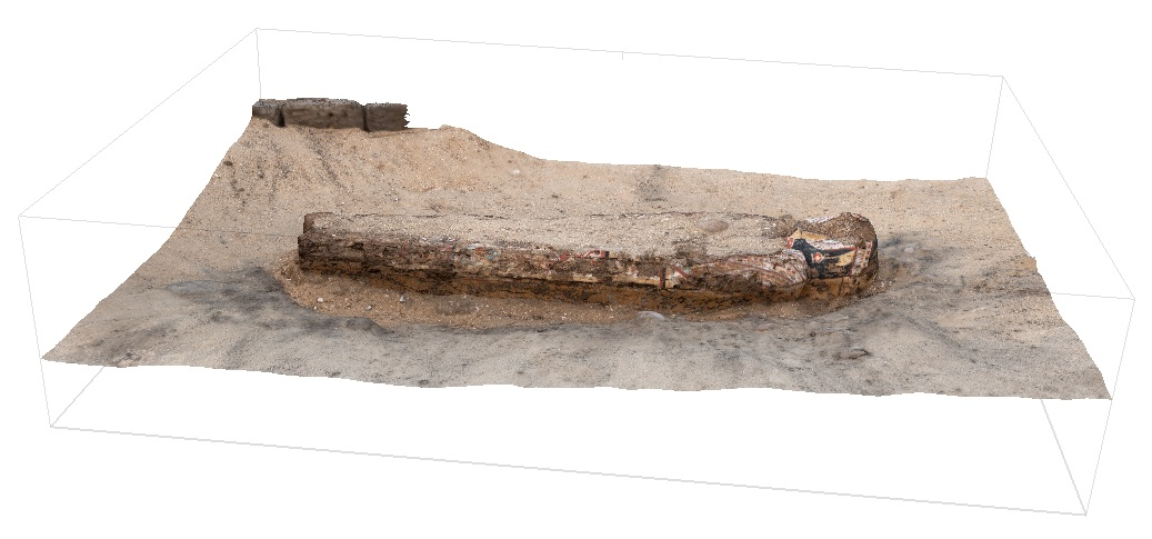 Fig.1. Scanning the painted coffin discovered this season outside the east corner gateway of the Shunet el-Zebib. Photo: Blair Simmons / North Abydos Expedition © 2019