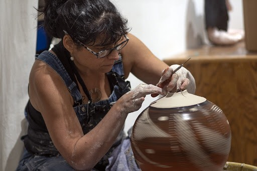 Lynne Meade gives wheel thrown pottery demo at Oakland Art Murmur