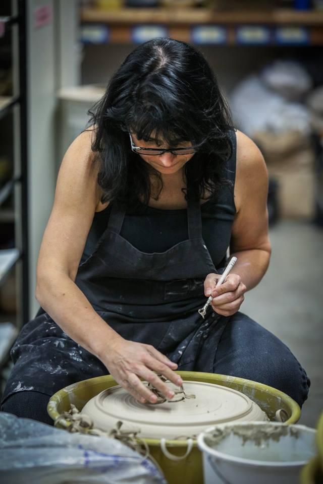 Lynne Meade demonstrates how to trim a ceramic pot at the Palo Alto Art Center where she currently teaches