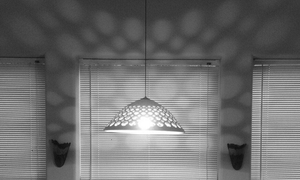 Pierced openwork pendant in dining room of private residence, Oakland, CA