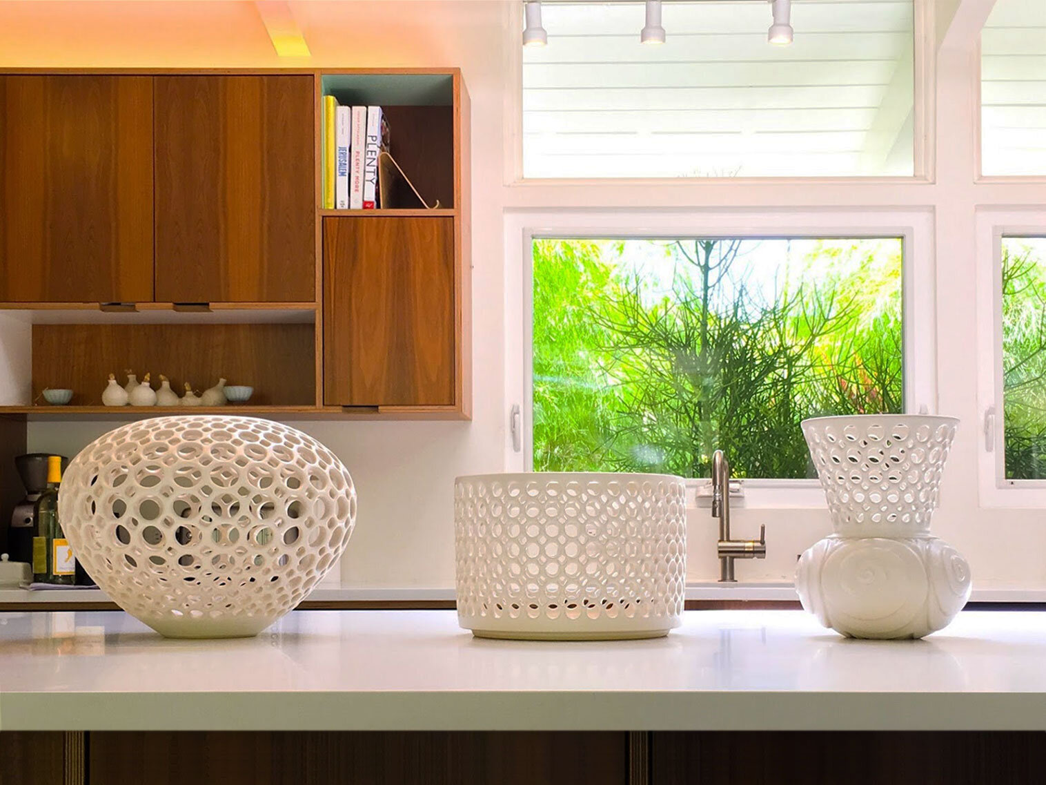 Pierced lace orb vessel, lace cylindrical bowl, spiral shell pierced and carved vessel in kitchen of Eichler private residence, Palo Alto, CA