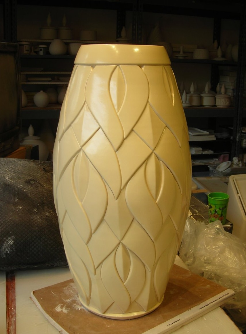 Finished carved and fired vessel    Cylindrical Round Full Lotus Vase  by Lynne Meade was commissioned for the renovation of the landmark Art Deco  Raleigh Hotel  in Miami Beach (South Beach), FL, originally designed and built in the early 1940s by  architect L. Murray Dixon , a principal architect of Deco South Beach, and known for its international cachet with models and celebrities.