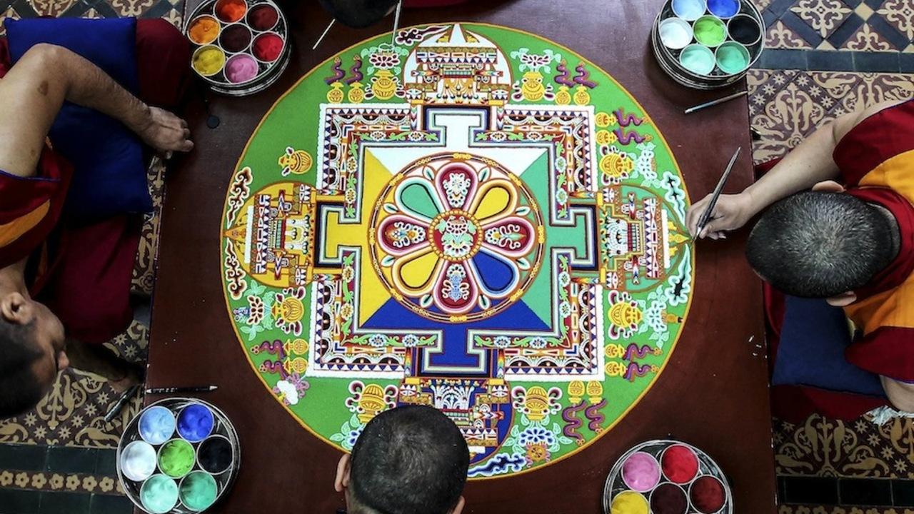 The intricate ancient art of sand mandala creation