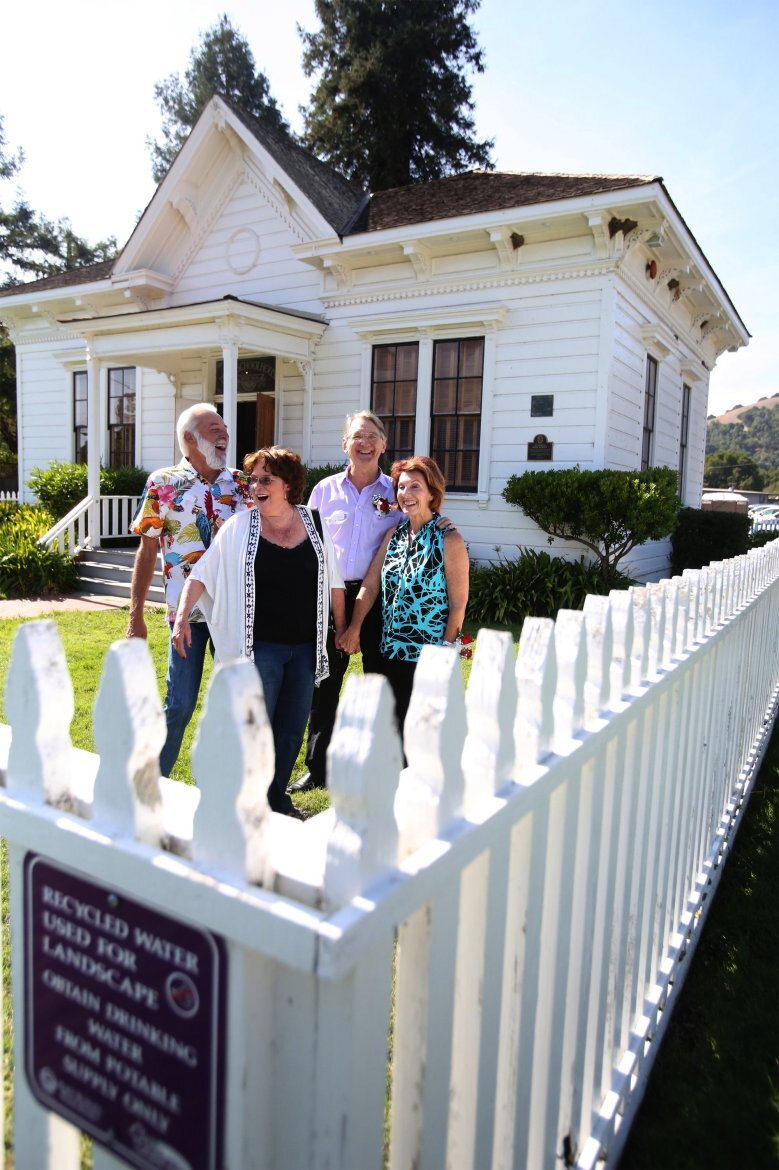 Steve Robinson, Lorna King, Paul Ennis and Jacquie Hill-Durand stand for a photo in front the Dixie Schoolhouse in celebration of the 62nd kindergarten class reunion on Saturday, Oct. 12, 2019 in San Rafael, Calif. (Frankie Frost/Special to the Marin Independent Journal)