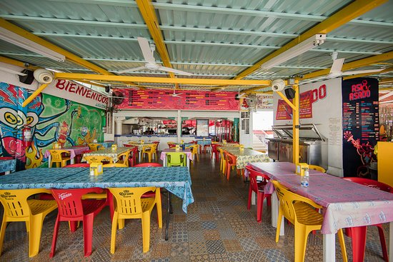 Asi y Asado   | Carretera Transpeninsular KM 3.8, El Tezal Tel: +52 624.105.9500 - info@asiyasado.com  Adam has been going to this roadside build-your-own taco stand since long before Guy Fieri put it on the map. Enjoy the bright colors, great variety, quick service and never-ending salsa bar. If you've ever been to Cabo with Adam, chances are you've already experienced the best tacos in Baja.