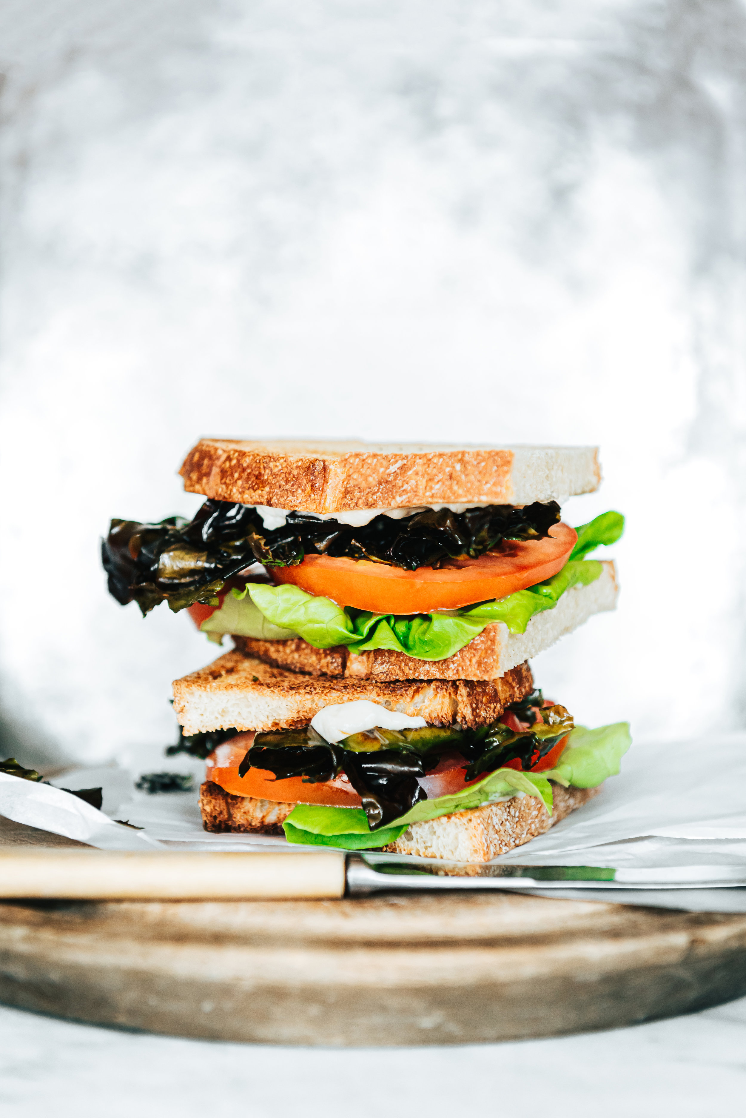 Classic B.L.T. (D.L.T.) - Have a craving for the classic B.L.T.? Try a D.L.T. instead!In this recipe substitute the bacon out for dulse leaves fried in oil until green and add it to any sandwich you'd put some bacon in!Ingredients:- Fry dulse leaves in a frying pan with some oil until a deep, rich green colour- Toast 2-3 pieces of rustic bread- Slice tomatoes to personal preference- Wash lettuce and tear to desired size- Spread mayonnaise on toast and layer other items to create a D.L.T.Optional: add chicken to make a seaside inspired chicken club!