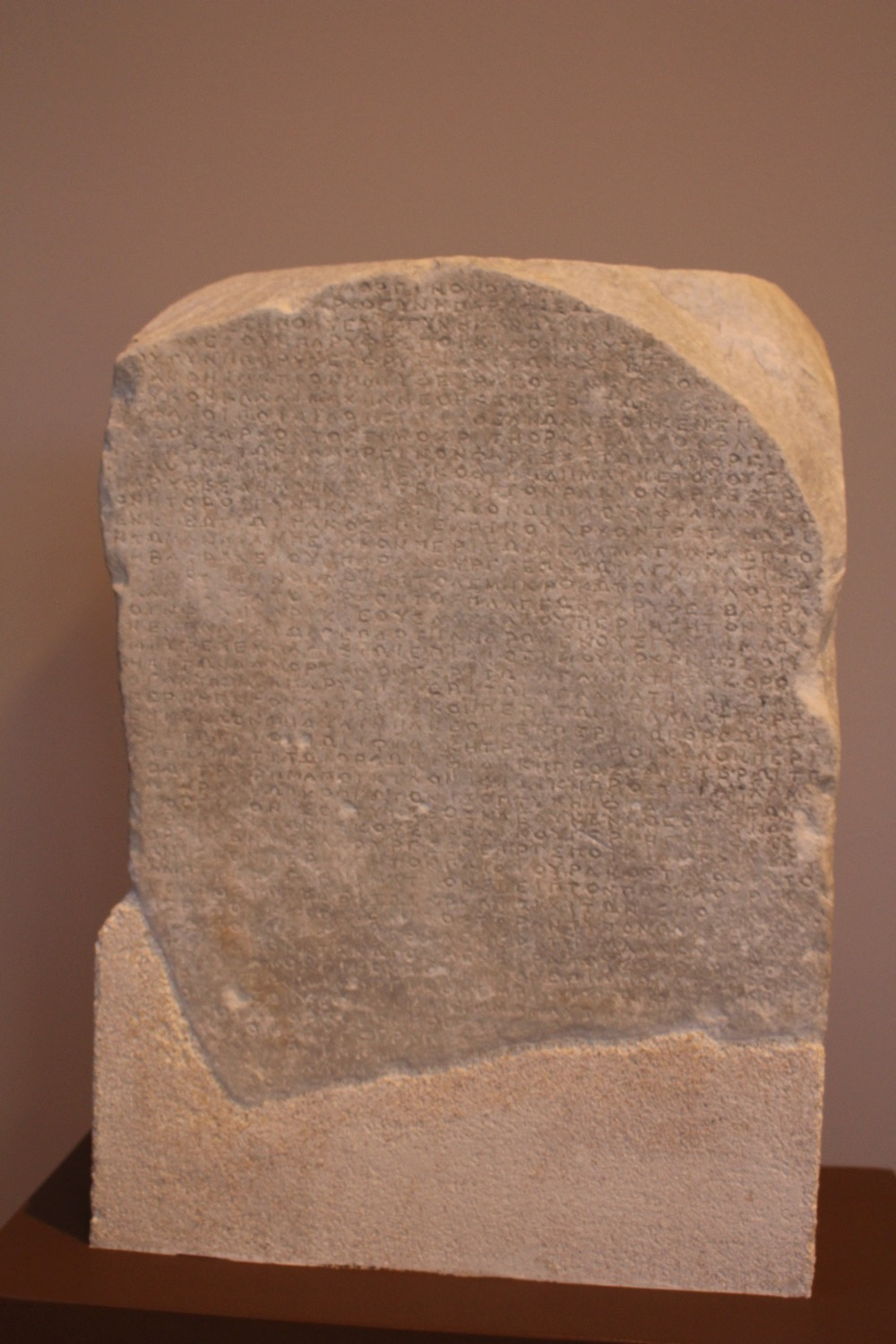 A marble plaque carved with dedications