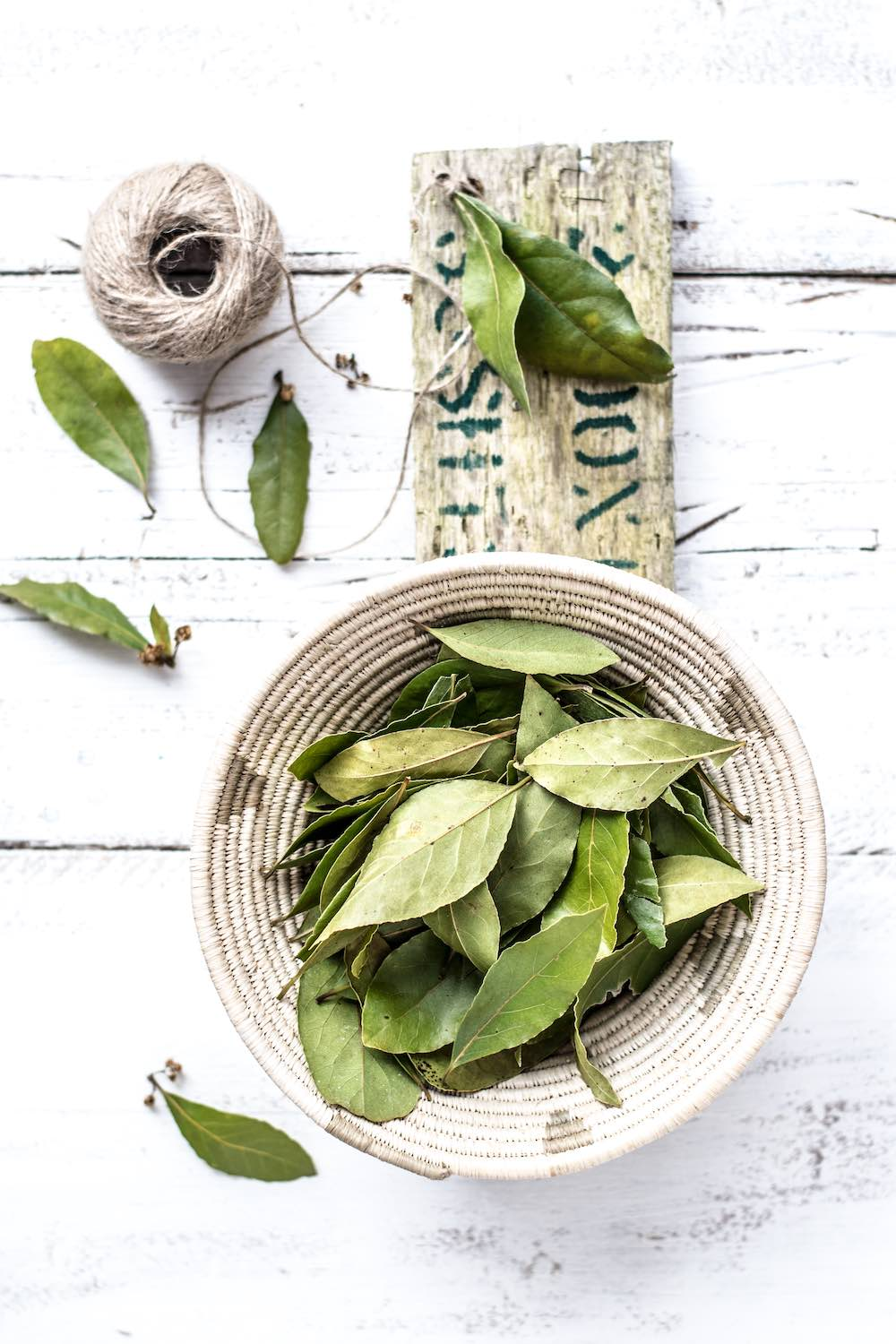 Dried bay leaves in a woven basket