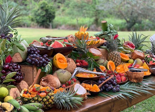 Ke Nui Kitchen's gorgeous tropical fruit table! 🍓🍇🍎🍏🍐🥥🍍🥭🍉🍑🥝. #kenuikitchen  #fruit #tropicalwedding #tropical fruit #hawaii #dillinghamranchwedding #girlchefsrock #bestcatering #papaya #fruitboard #fruittable