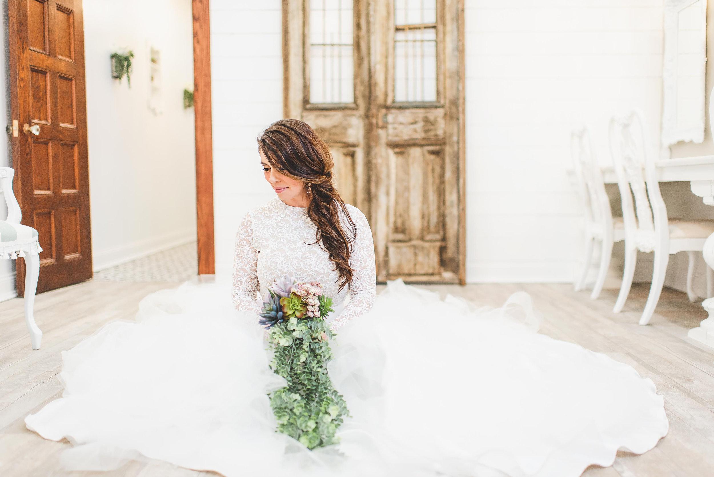 lisa seated in floor of bridal room.jpeg