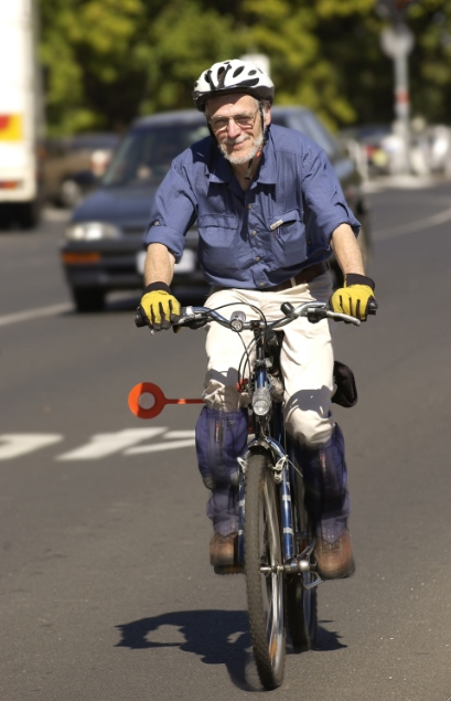 Frank Fisher getting around the streets of Melbourne by the most efficient means possible.