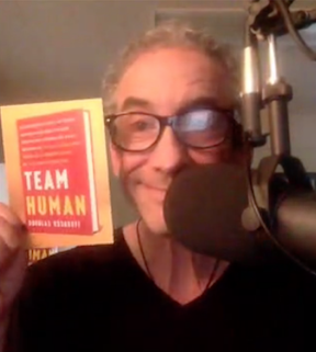 Douglas Rushkoff speaking with Anthony from his New York office, replete with Team Human props.