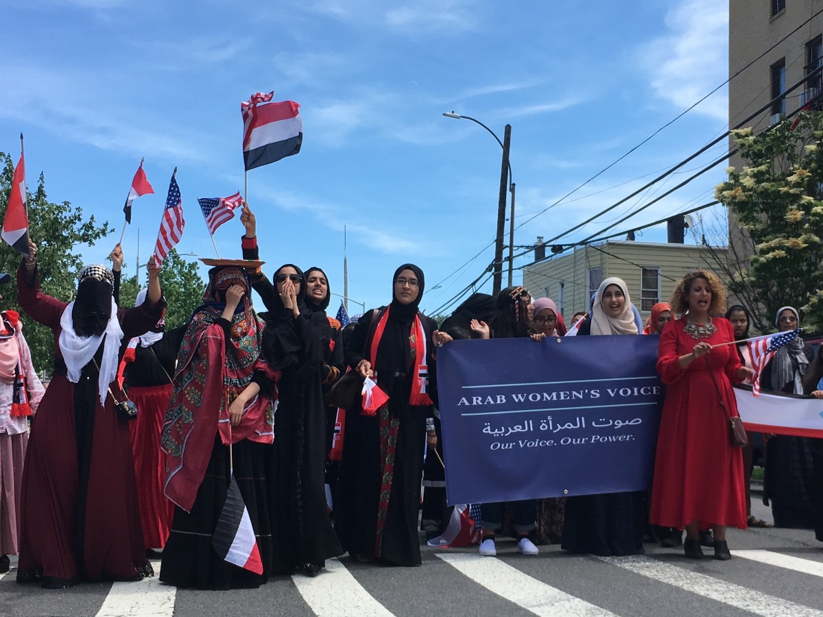 Arab Women's Voice women and girls marching at the first annual Yemeni American Day Parade in 2019