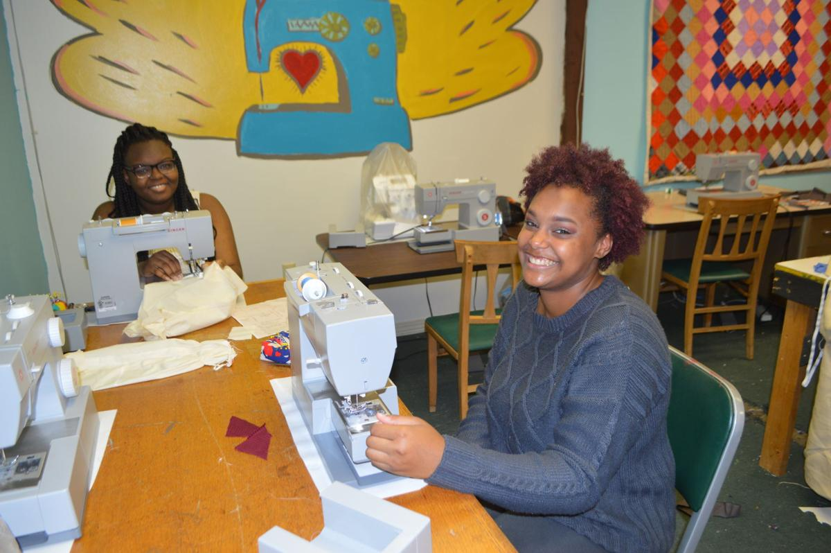 """Sewing costumes at ArtPlace Mississippi are Paige Wilson, left, a Shakespeare summer camp volunteer who was a member of last year's """"Summer Scene Fest"""" cast, and Aaliyah Evans, a fourth-year Shakespeare camper."""