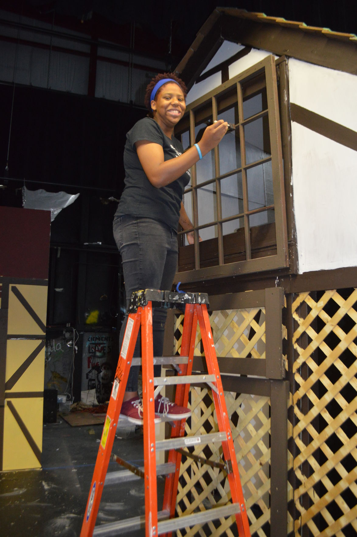 """Niobi Elliott paints the balcony where she will stand from while performing her role as Juliet in """"Romeo and Juliet."""""""