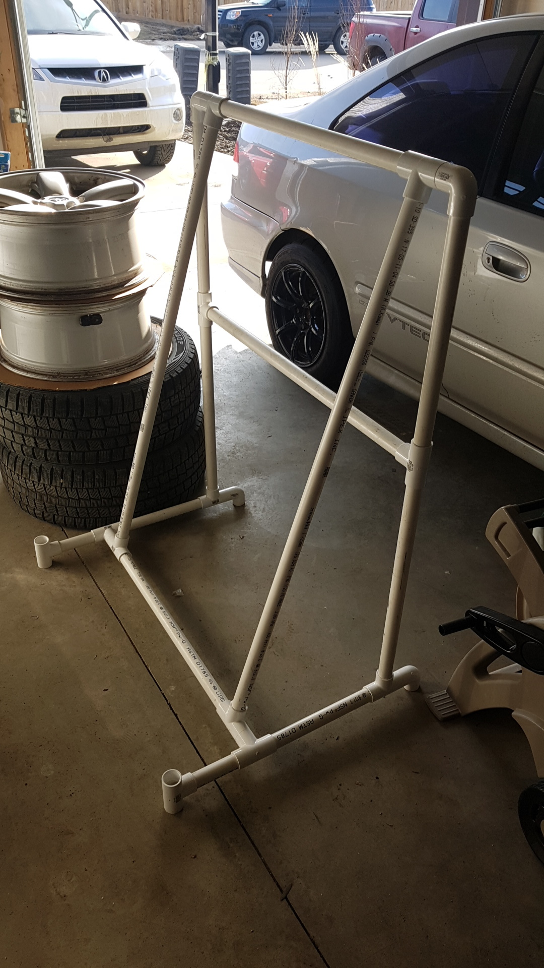 """Honestly love the feeling of an open top roadster during my weekly summer Sunday night drives. This means I needed to store the hardtop. Looked around and found that the """"heavy duty"""" stands can cost upwards of $600!!! Fuck that shit. Found a tutorial and built one myself. PVC pipe cost around $70 and looks pretty good too! The dimensions are based off of plans I found for a miata. Link here:  https:// www.youtube.com /watch?v=nuyyHr1JaDA.  Highly recommend this as it took me maybe an hour to build."""