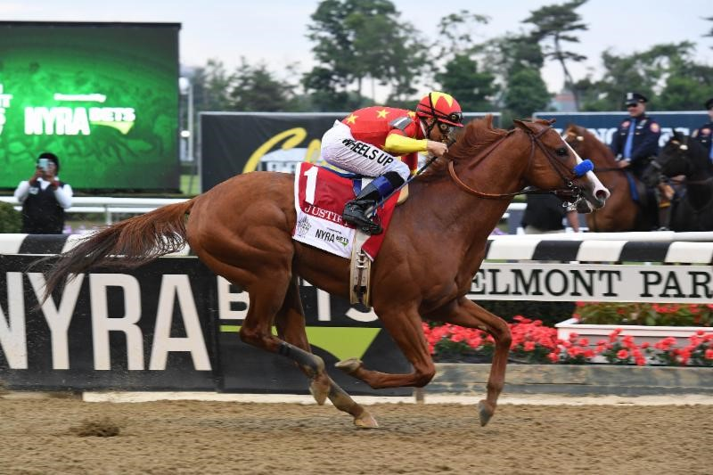 Mike Smith and Justify. Photo by Adam Coglianese